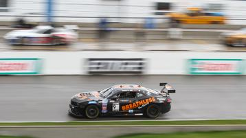Ernie Francis, Jr., leads six cars for damp practice